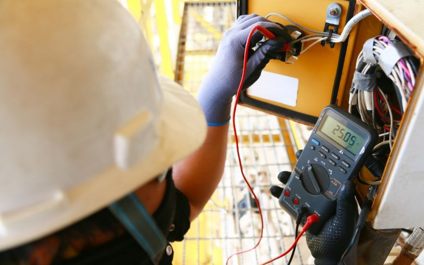 Electrical Terminal Being Serviced By Technician