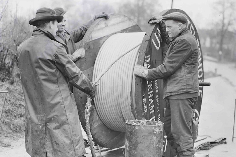 Engineers laying underground cable, 1951.