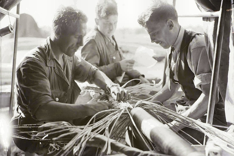 Engineers soldering and jointing telephone cable, 1945.