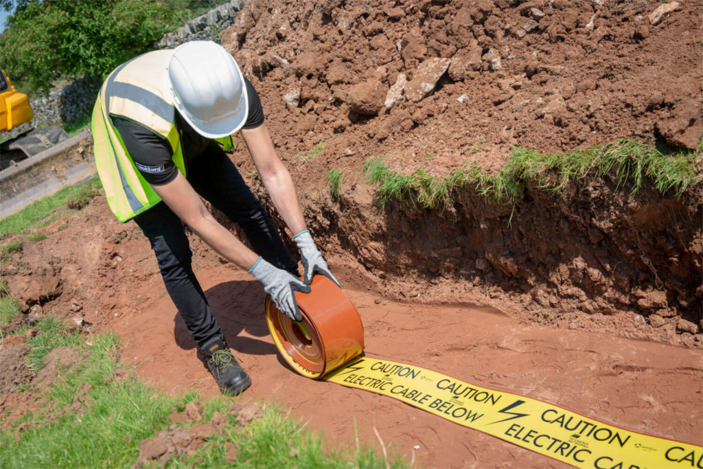 Tapetile cable warning tape manufactured by Centriforce is rolled out into the cable trench for quick and easy protection of low voltage, high voltage, street lighting and underground electricity cables up to 11kV.